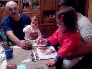 Vladimir Shustrov - my father in law (with his granddaughter Dasha on his knee, and his other granddaughter Sophia)