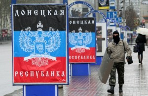 An armed soldier of the People's Republic of Donetsk patrolling the streets