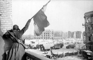 A soldier waves the Soviet Union's flag in Stalingrad - modern day Volgograd - in 1943.